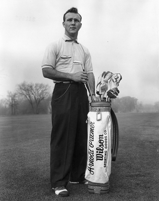 circa 1953: A full-length portrait of American golfer Arnold Palmer pulling a driving iron from a golf bag on a golf course. (Photo by Hulton Archive/Getty Images)